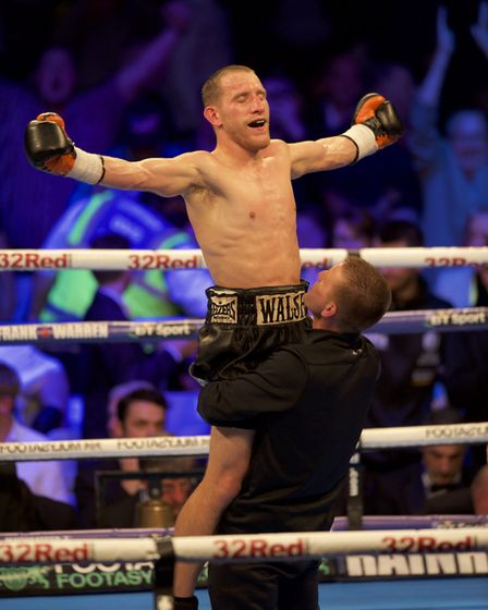 Ryan Walsh celebrates winning his fight against Marco Mccullough during their British Featherweight