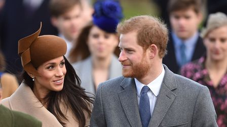 Prince Harry and Meghan Markle arriving to attend the Christmas Day morning church service at Sandri