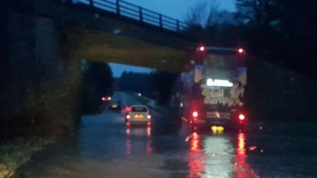 The bus in the flooded underpass on the Dereham Road at Scarning, under the A47 bridge. Picture: Oll