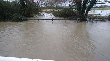 Podmore Lane in Scarning is flooded at the ford near Rushmeadow Road. Picture: Paul Knock