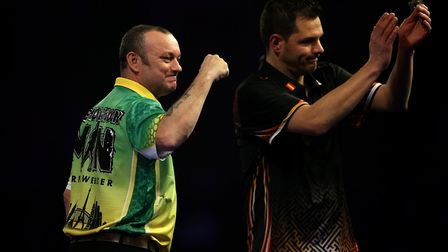 Darren Webster celebrates after cruising past Toni Alcinas on day 12 of the William Hill World Darts