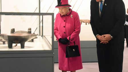 The Fiji High Commissioner to the UK, Jitoko Tikolevu shows the Queen some of the exhibits during he