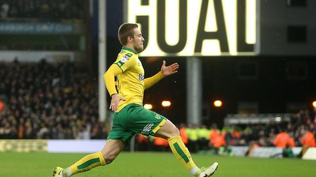 Tom Trybull enjoys the moment after his first league goal for Norwich had restored parity.