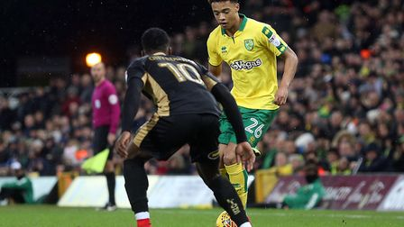 Jamal Lewis stands up Fred Onyedinma during an impressive full home debut for the Norwich City acade