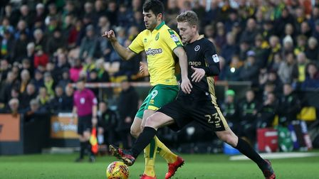 City striker Nelson Oliveira has Millwall's George Saville for company.