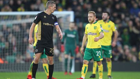 Alex Pritchard of Norwich and Steve Morison of Millwall clash after the former Canary had opened the