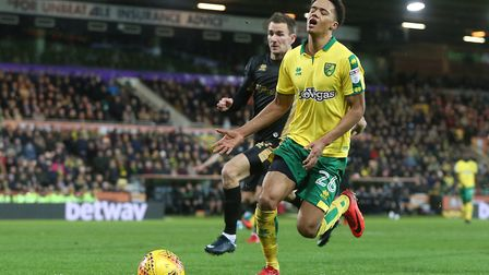 Jamal Lewis of Norwich just can't get on the end of a through ball by Alex Pritchard of Norwich duri