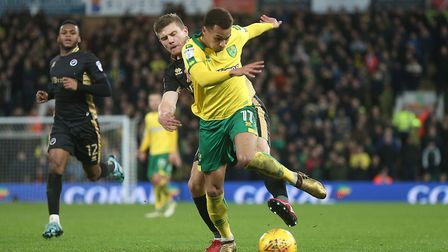 Josh Murphy of Norwich and Shaun Hutchinson of Millwall in action during the Sky Bet Championship ma