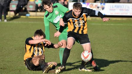Midfield action from the Boxing Day derby between Gorleston and Great Yarmouth Town at Emerald Park.