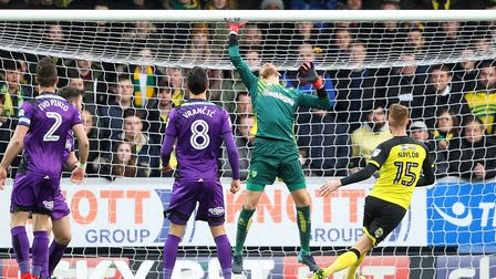 Angus Gunn of Norwich makes a great save from a header by Tom Naylor of Burton Albion during the Sky