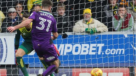 Grant Hanley clears in front of the watching Norwich City supporters that made the trek west to Burt