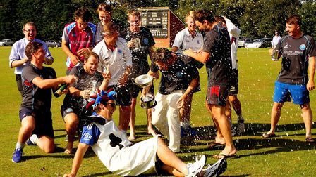 The champagne flows as Swardeston celebrate their ninth Carter Cup triumph. Picture: Tim Ferley