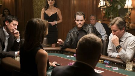 Jessica Chastain as Molly Bloom surveys a high-stakes poker game in Mollys Game. Photo: Entertainmen
