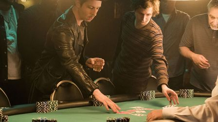 Jeremy Strong as Dean Keith and Michael Cera as Player X in Mollys Game. Photo: Entertainment One/M