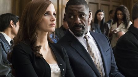 Jessica Chastain as Molly Bloom and Idris Elba as Charlie Jaffey in Mollys Game. Photo: Entertainmen