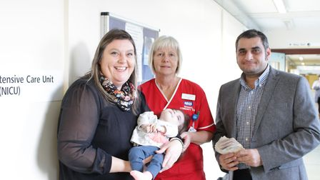 Alison Hipkin with Evie and Pete Lavvaf with neonatal nurse Julie Oughton. Picture: Victoria Fear