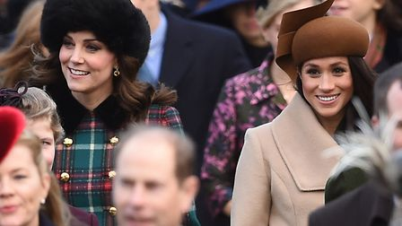 The Duchess of Cambridge (left) and Meghan Markle arriving to attend the Christmas Day service. Pict