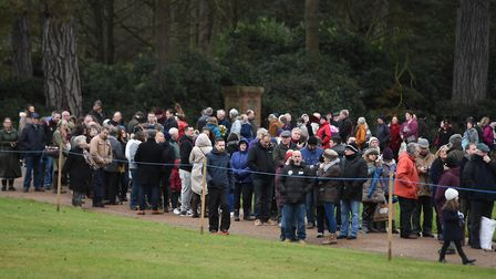 Members of the public wait for the royal family to attend the Christmas Day morning church service a