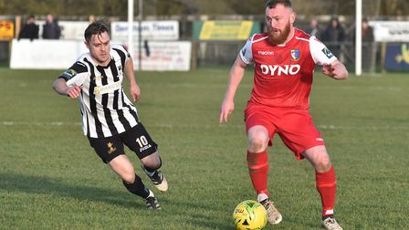 Action from the derby clash between Dereham Town and Norwich United. Picture: Sonya Duncan