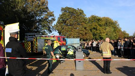 The school's car park turned into the scene of a car accident. Picture: Carmina McConnell