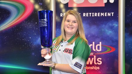 Katherine Rednall with her Just 2017 World Indoor Bowls Ladies Champion trophy. Picture: Photowizar