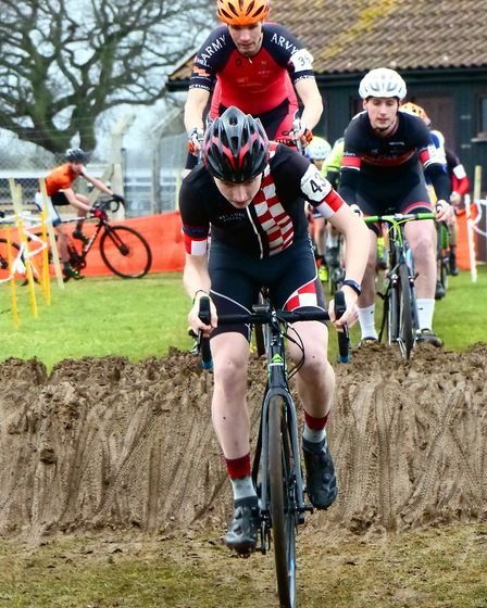 Fakenham rider Connor Rumbles leads a group off the sand table at the Trinity Park cyclo-cross. Pict