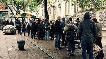 People queuing for food at the larger stall on Hay Hill, which needs repairs according to Norwich Ci