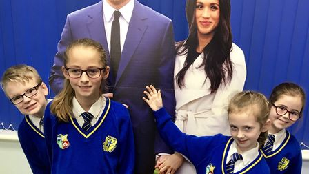 Howard Junior School pupils with the cut-outs of Prince Harry and Meghan Markle. Picture: Howard Jun