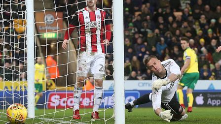 Ivo Pinto's looping header was not enough to prevent Sheffield United beating Norwich City 2-1 at Ca