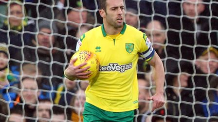 Ivo Pinto rallies his Norwich City team-mates after Sheffield United's opening goal at Carrow Road.