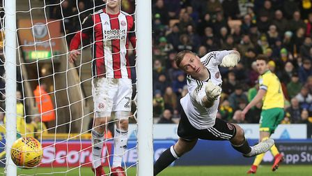 Ivo Pinto watches his looped header land inside the Sheffield United net. Picture by Paul Chesterton