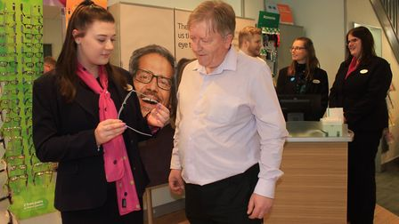 Specsavers optical assistant Jade Eglington shows Nigel Harris the range of frames on offer at the c