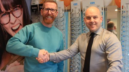 Former Norwich City footballer Iwan Roberts Sheringham Specsavers store with opthalimic director Kev