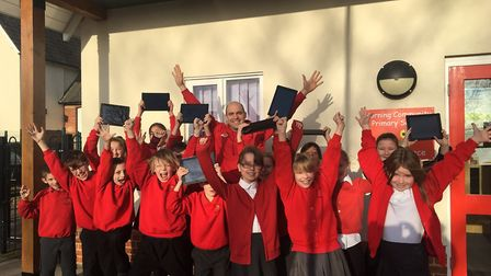 Headteacher Chris Aitken with pupils at Horning Primary School, celebrating their £25,000 win from t