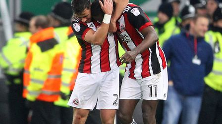 Clayton Donaldson celebrates scoring Sheffield United's second goal as they left Carrow Road with vi
