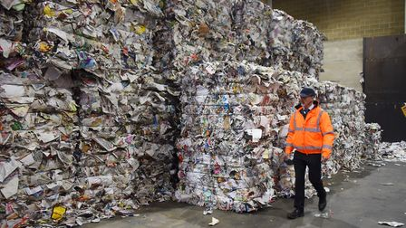 Steve Jenkins, contracts manager, with the baled quality standard paper for China at the NEWS recycl