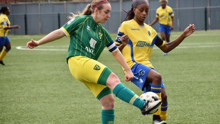 Captain Emily Moerkerk wins the challenge for Norwich City Ladies against Haringey Borough. Picture: