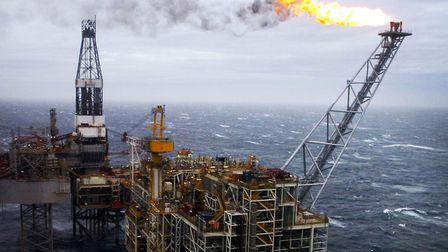 An oil rig in the North Sea. Britain's economy is forecast to have held up in the fourth quarter, bu