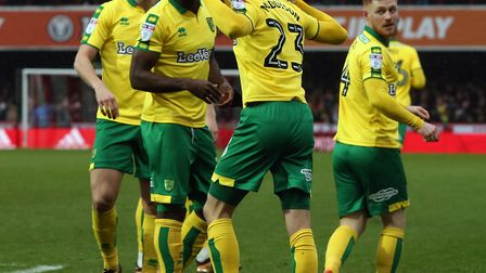 James Maddison of Norwich celebrates scoring his side's first goal during the Sky Bet Championship m