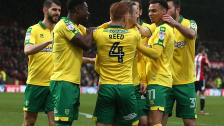 James Maddison is mobbed by his team mates after a Griffin Park superstrike. Picture: Paul Chesterto