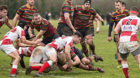 Robbie Bridgstock powers his way towards the try line as Norwich turn on the style in Epping. Pictur