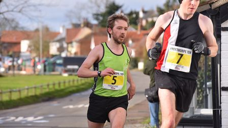 The leading runners pass through Reedham during the Freethorpe 10m race.Picture: Nick Butcher