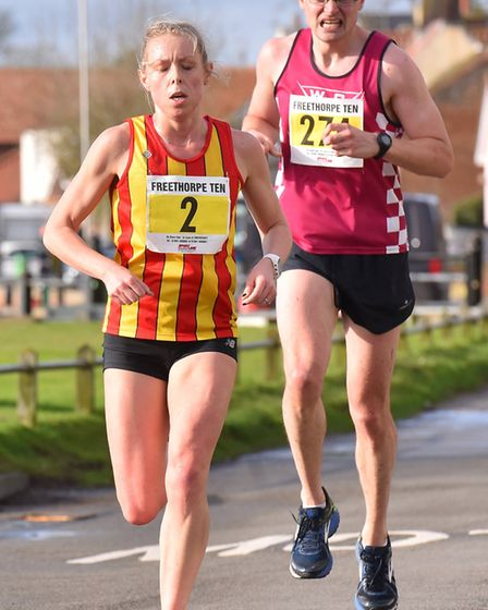 Runners passing through Reedham during the Freethorpe 10m race.Picture: Nick Butcher