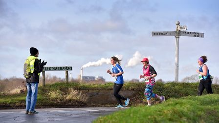 Running like a steam train! Competitors pass the Cantley Sugar factory during the Freethorpe 10m ra