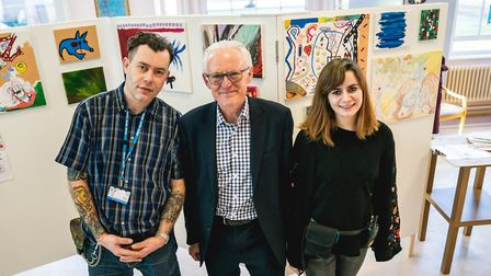 Jake Whitbread, Norman Lamb MP and Clara Price with some of the artwork. Photo: NSFT
