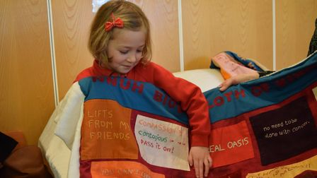 Elspeth Wright, aged 6, with the cloth of kindness to which she contributed. Photo: Big C