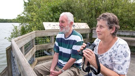 Birdwatching from the viewing platform at Barton Broad boardwalk. Picture: James Bass Photography