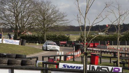 Chris West and Keith Hounslow tackling the Snetterton paddock section with their winning Peugeot 306