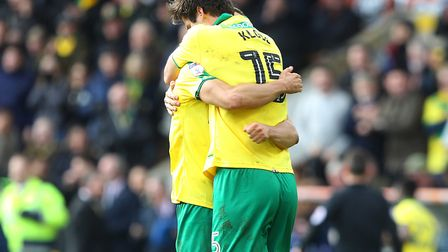 It was hugs all round as Norwich City salvaged an injury-time equaliser to peg back Ipswich Town in