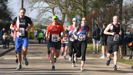 A collection of runners approach the finish line at the Valentine 10K. Picture: Ian Edwards Photogra